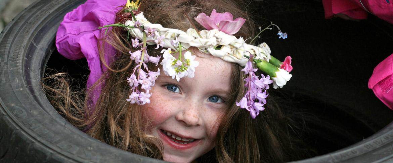 girl in tyre wearing flower crown